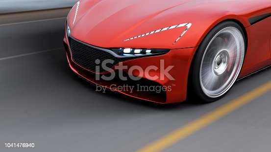istock red car driving on a road by sea 1041476940