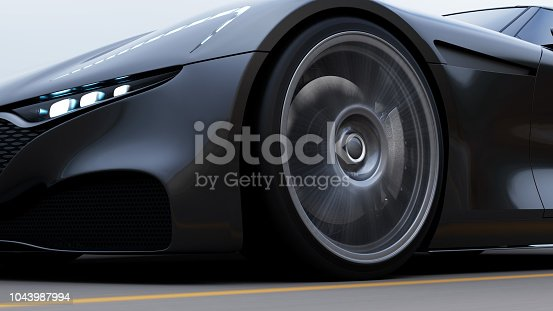 istock red car driving on a road by sea 1043987994