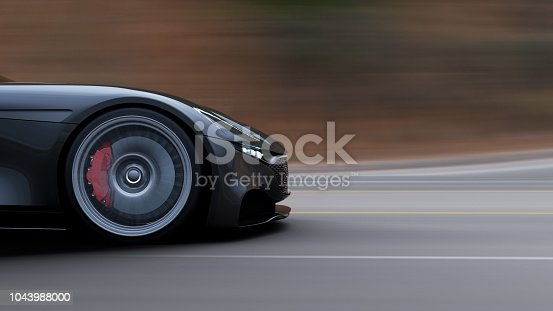istock red car driving on a road by sea 1043988000