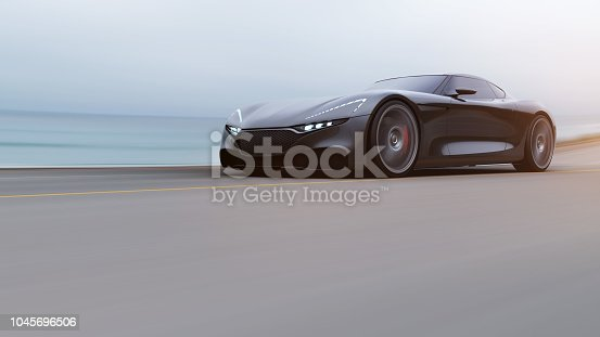 918555756 istock photo red car driving on a road by sea 1045696506