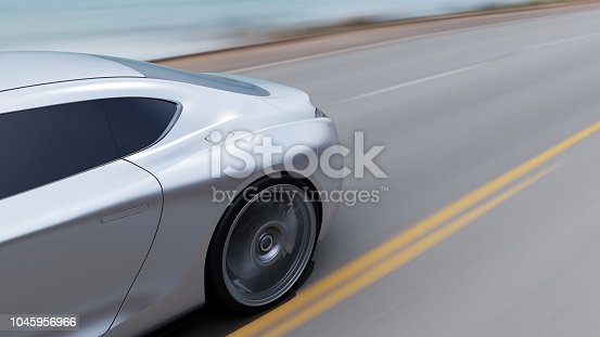 istock red car driving on a road by sea 1045956966
