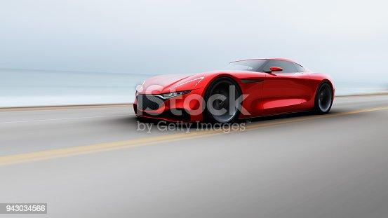 istock red car driving on a road by sea 943034566