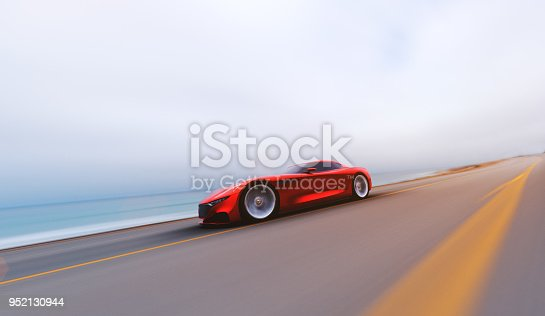 918555756 istock photo red car driving on a road by sea 952130944