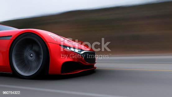 918555756 istock photo red car driving on a road by sea 960754322