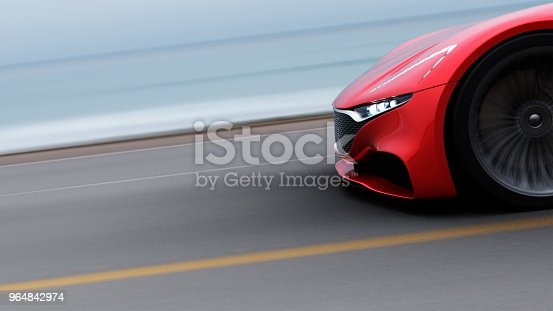 918555756 istock photo red car driving on a road by sea 964842974