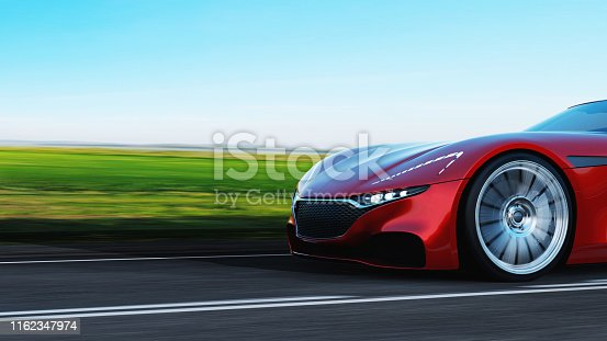 istock red car driving on a road 1162347974