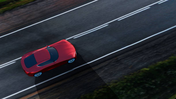 red car driving on a road top view of fast moving red car, road in fields, motion blur,  3D, car of my own design. concept car stock pictures, royalty-free photos & images