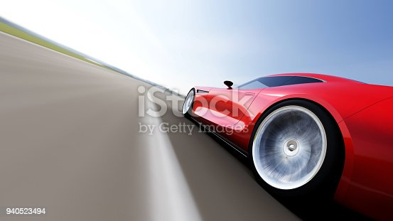 918555756 istock photo red car driving on a road 940523494
