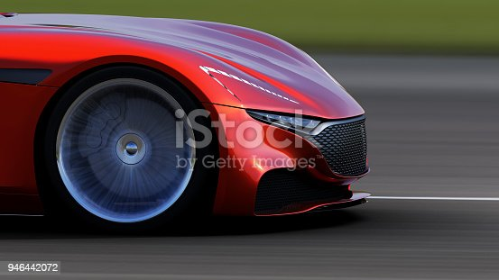 918555756 istock photo red car driving on a road 946442072