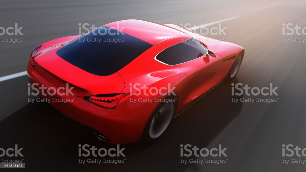 red car driving on a road royalty-free stock photo