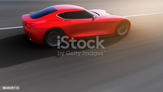 istock red car driving on a road 964848110