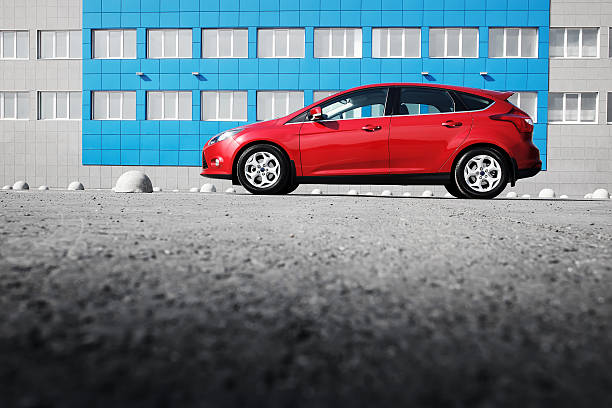 red car ford focus iii sport parked in the city - ford focus stock photos and pictures