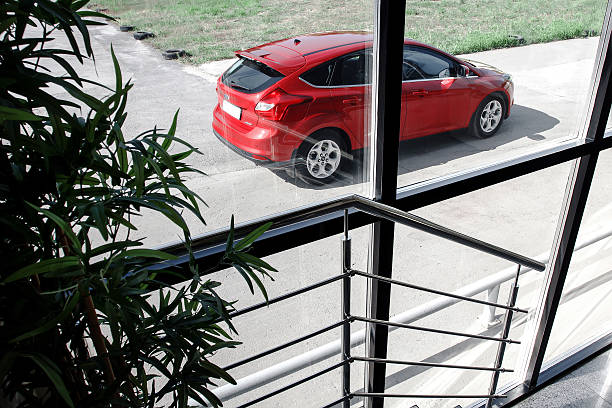 red car ford focus iii sport standing on asphalt road - ford focus stock photos and pictures