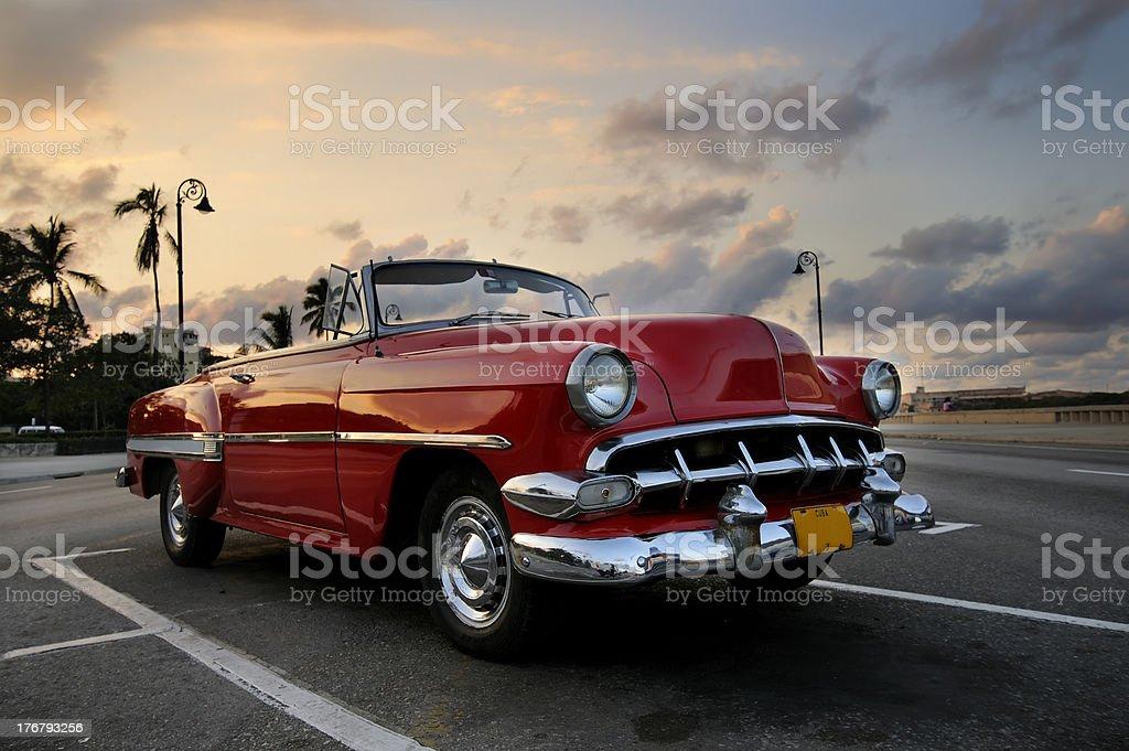 Red car in Havana sunset stock photo
