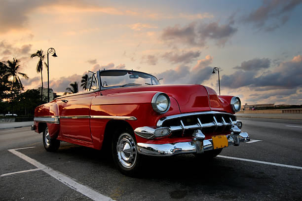 Red car in Havana sunset stock photo