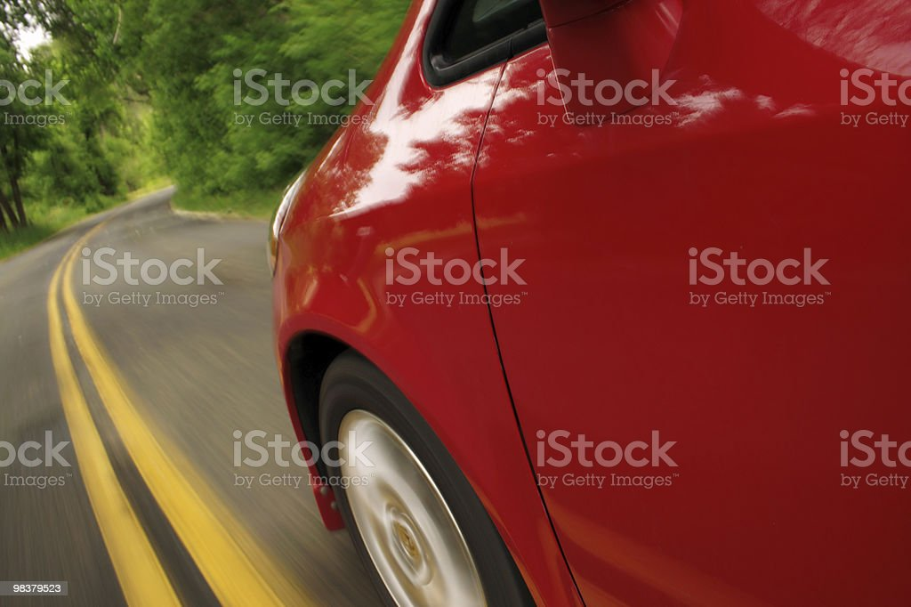 Red car in motion. Side view. stock photo