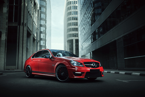 Red Car Mercedesbenz C63 Stay On Asphalt Road In City Stock Photo - Download Image Now