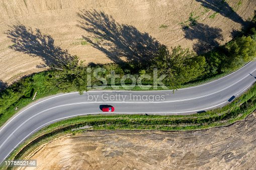 istock Red Car on Winding Road, Aerial view 1178852146