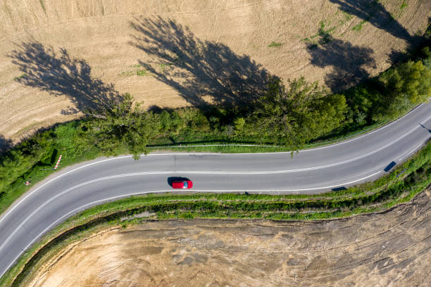 Red Car on Winding Road, Aerial view stock photo