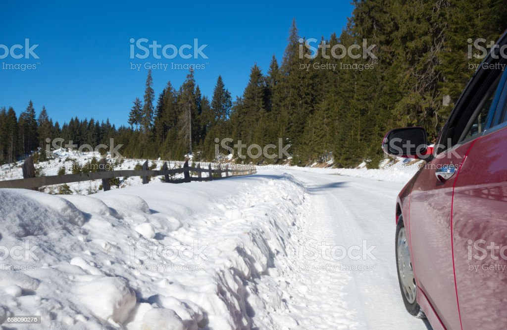 Red car on winter road royalty-free stock photo