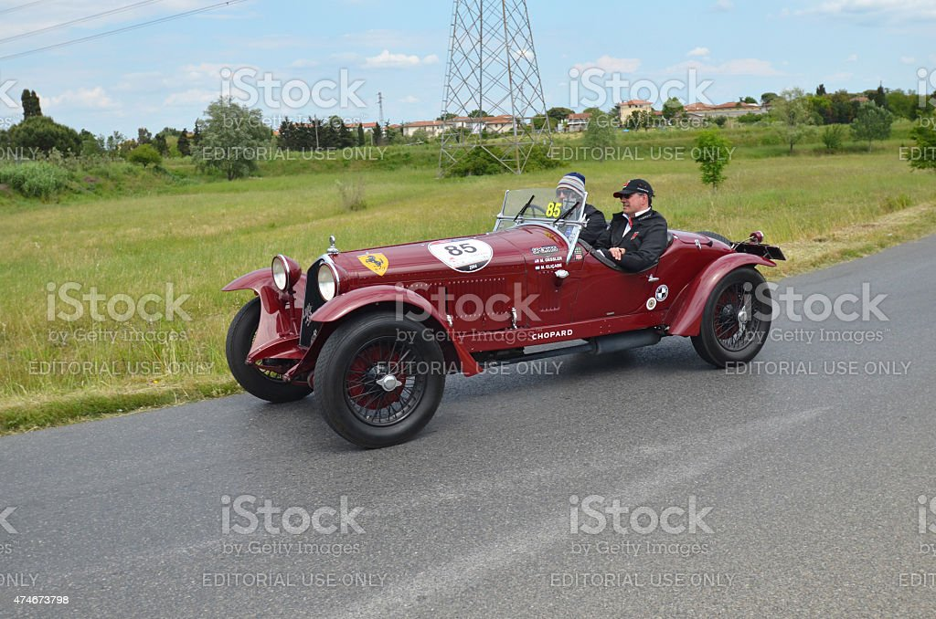 Red car racing the mille miglia race stock photo
