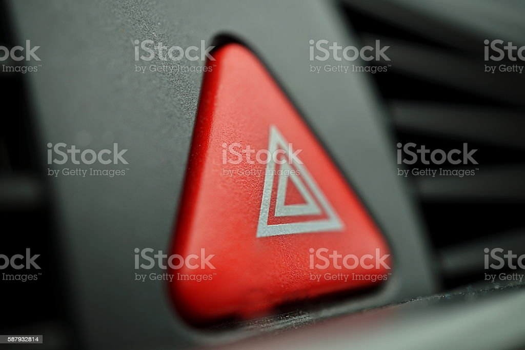 Red car Warning button with triangle switching vehicle indicators stock photo
