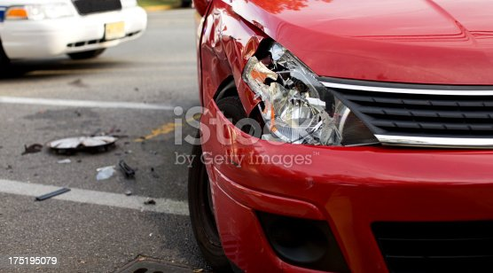 istock A red car with a damaged headlight after an accident 175195079