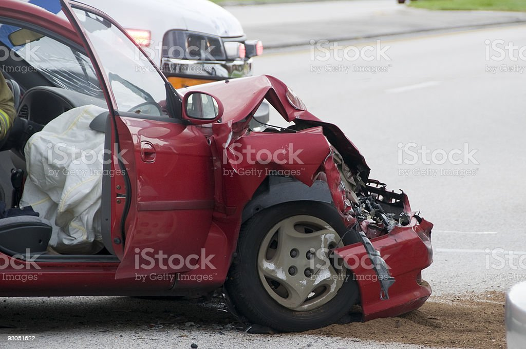 Red car with front crushed from vehicle accident stock photo