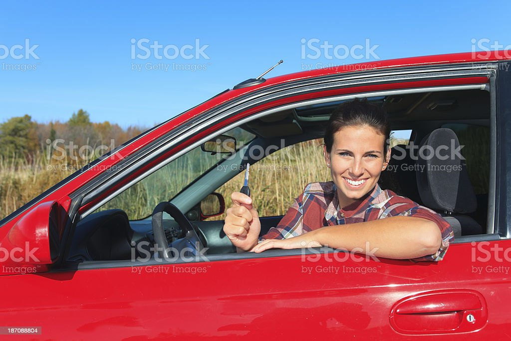 Red Car Woman - First Key royalty-free stock photo