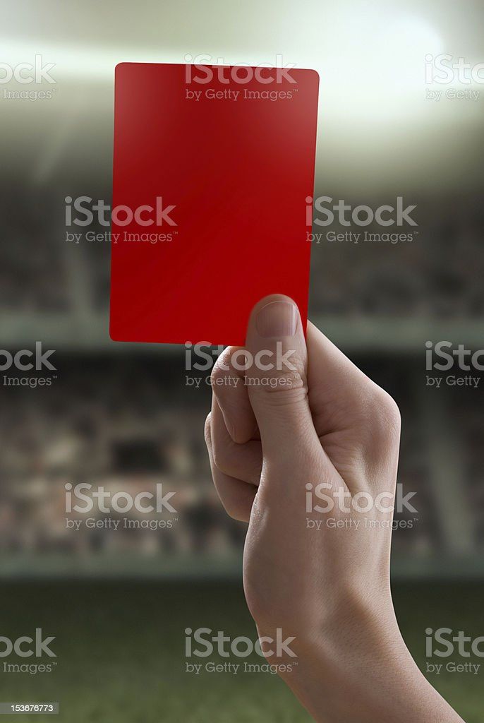 Red card with hand from referee giving a penalty stock photo