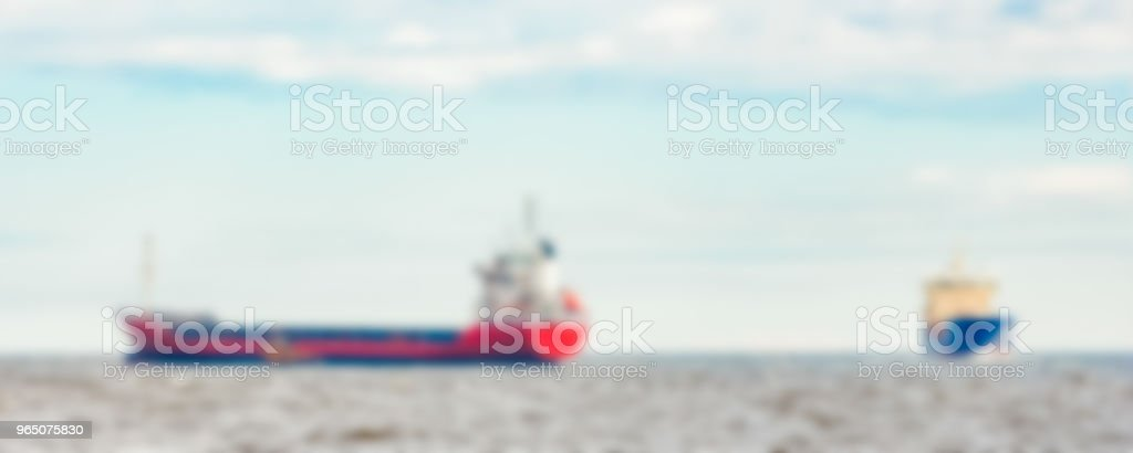 Red cargo ship - blurred image royalty-free stock photo