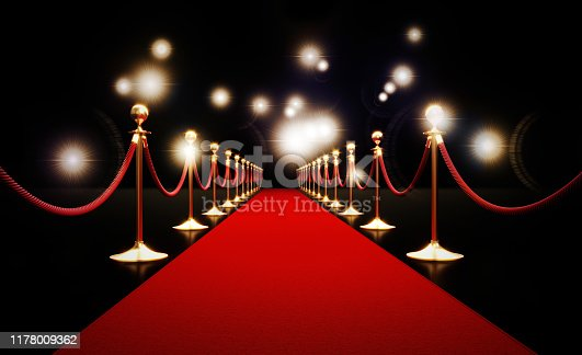 Red carpet and paparazzi lights on black background. Horizontal composition with copy space.  Great use for red carpet related concepts.