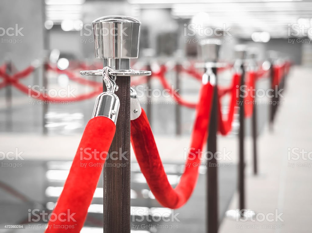Red Carpet Fence pole with Blurred interior background Red Carpet fence pole with red ropes with Blurred interior background 2015 Stock Photo