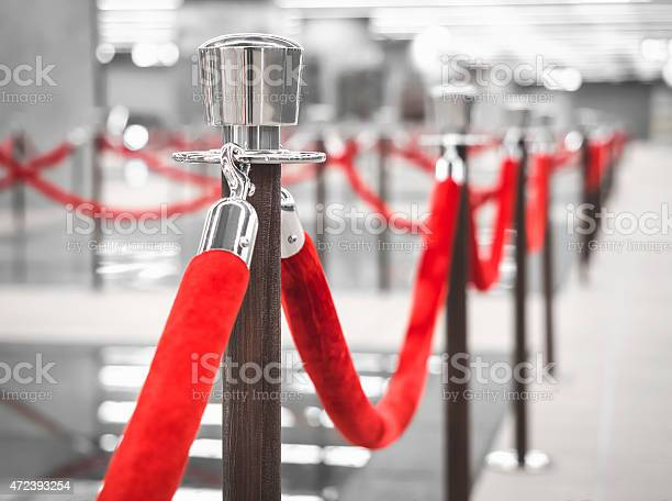 Red Carpet Fence Pole With Blurred Interior Background Stock Photo - Download Image Now