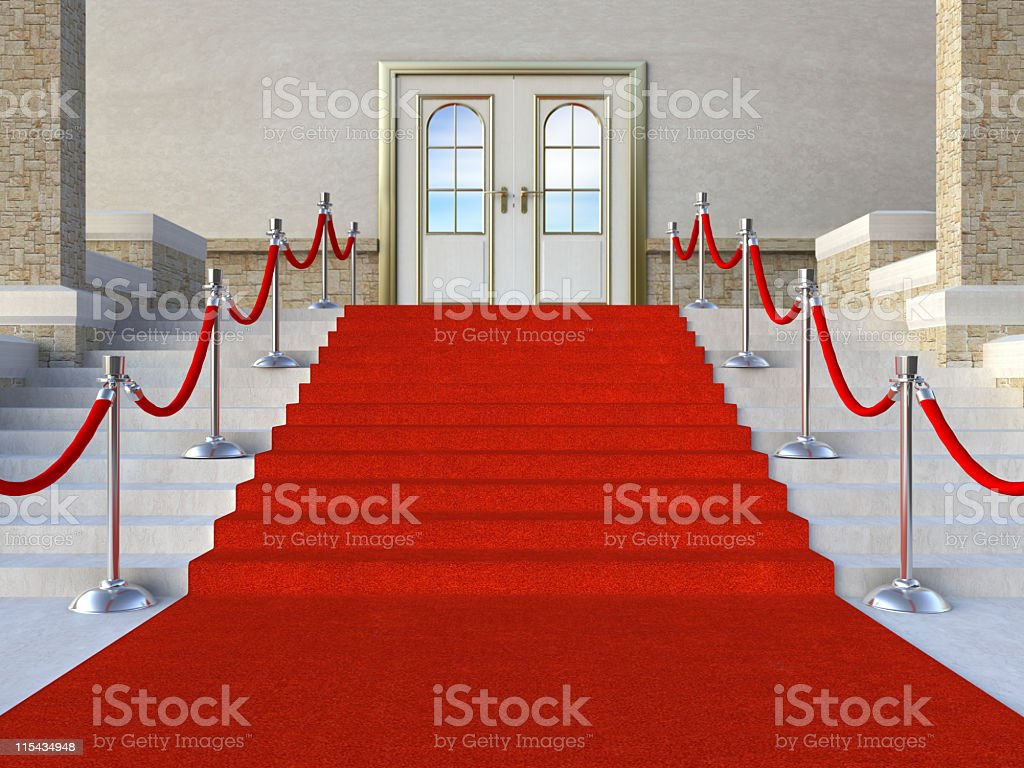 Red carpet leading to the door royalty-free stock photo