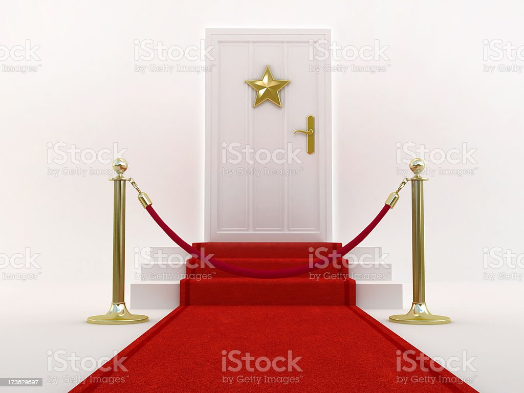 Red carpet leading to the door with star shape royalty-free stock photo