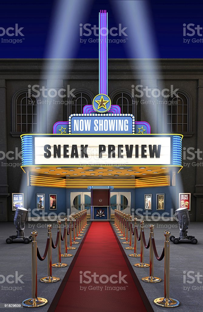 A red carpet leading up to a movie theatre stock photo