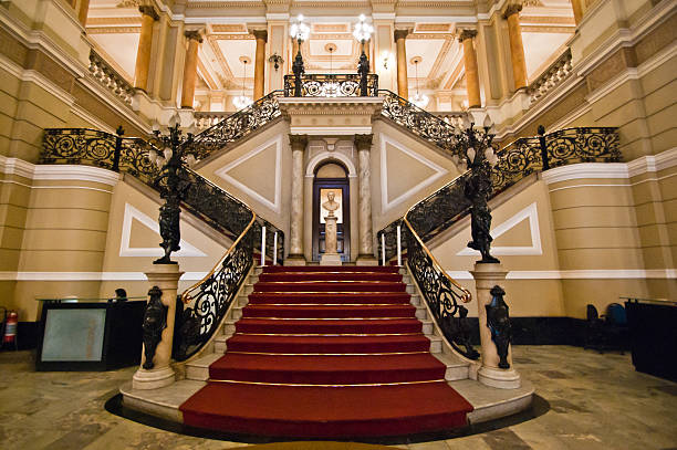 red carpet on stairway - majestic stock photos and pictures
