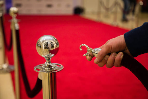 red carpet Red carpet with barriers and velvet ropes. Fame stock pictures, royalty-free photos & images
