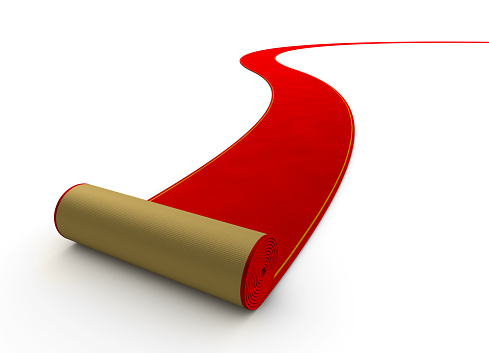 Red Carpet Rolling Out On A White Ground Stock Photo - Download Image Now