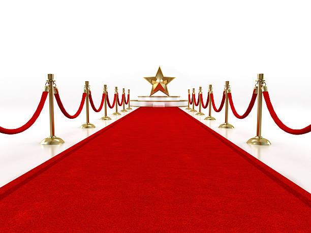roter teppich mit einem stern auf der bühne - oscar filme stock-fotos und bilder