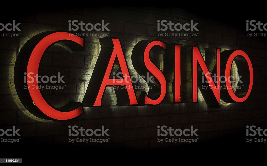 Red casino sign against dark background royalty-free stock photo