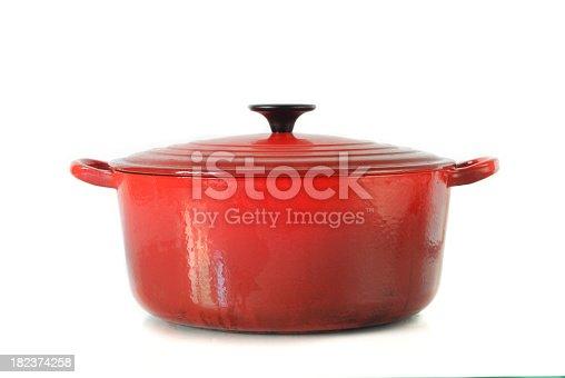 Well used orange casserole Dish