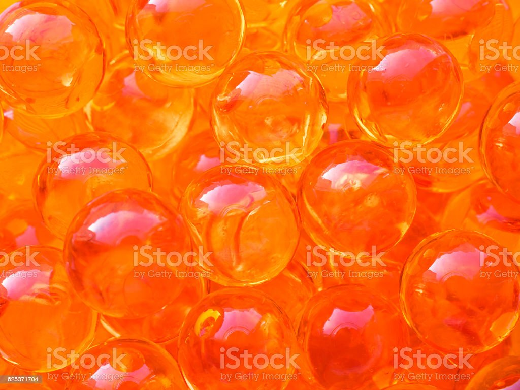 Red caviar bubbles close-up background. Protein healthy sea food stock photo