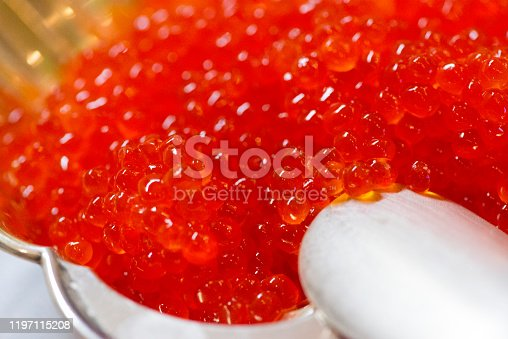 Red caviar in a silver bowl.