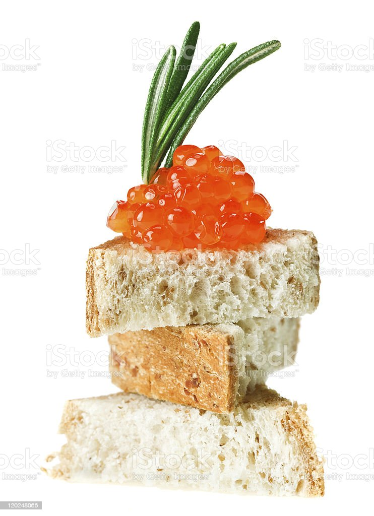 Red caviar sandwich with rosemary twig royalty-free stock photo