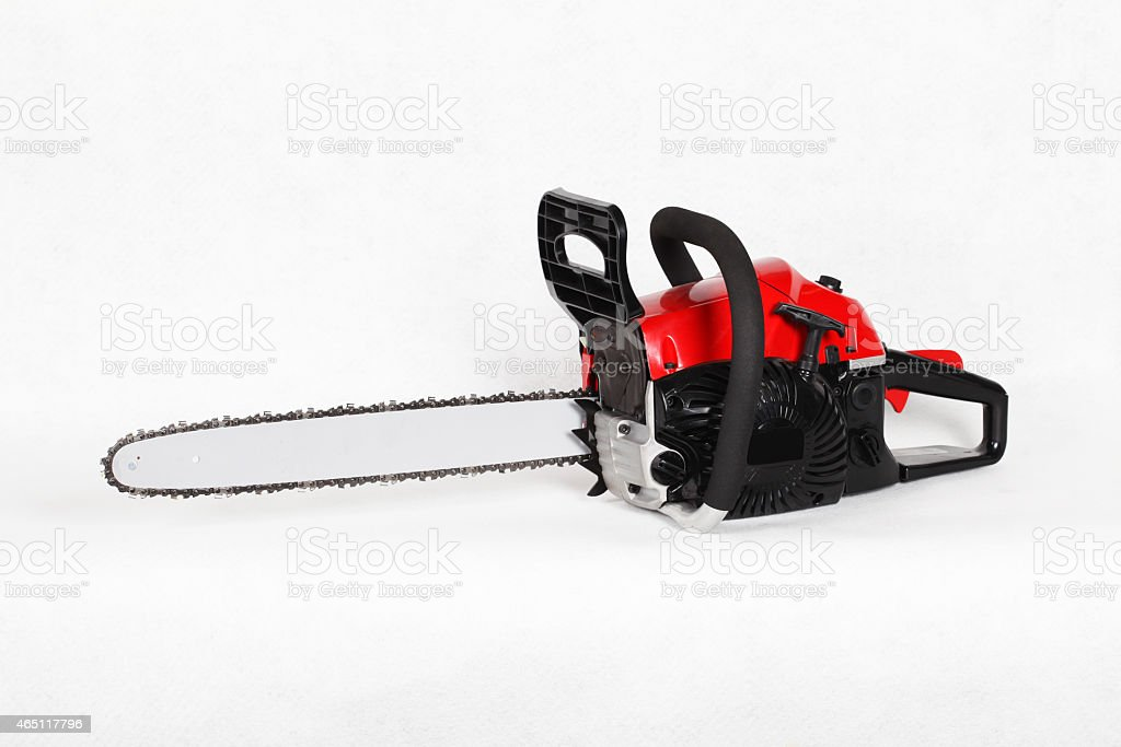 Red chainsaw isolated on white. stock photo
