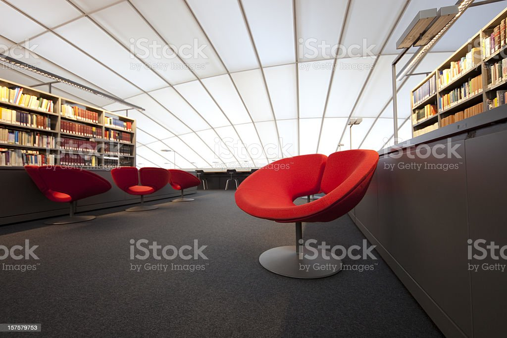 red chair at modern library royalty-free stock photo