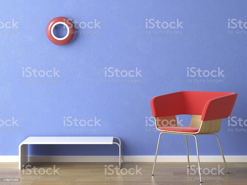 red chair on blue wall royalty-free stock photo