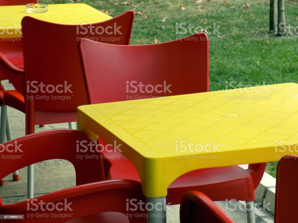 Red Chairs Around Yellow Table In The Restaurant Stock Photo Download Image Now Istock